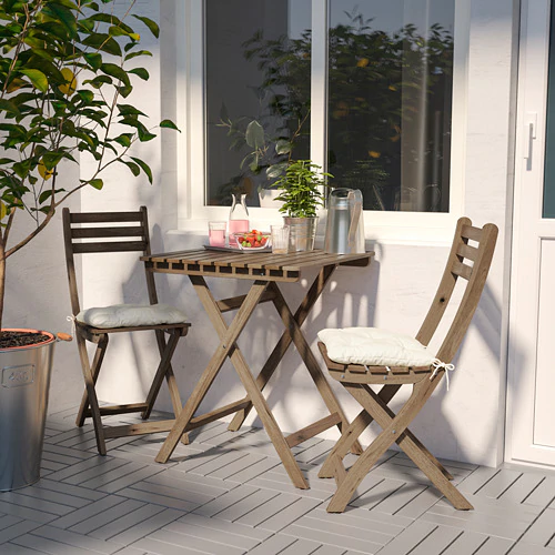 ASKHOLMEN Table+2 chairs, outdoor, graybrown stained, Kuddarna beige is part of Outdoor patio set - The cushion has a longer life because it can be turned over and used on both sides  Takes little room to store as both the table and the chair fold flat  For added durability, and so you can enjoy the natural expression of the wood, the furniture has been pretreated with a layer of semitransparent wood stain