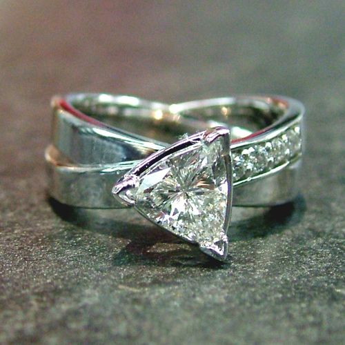 53c5ea71b A unique triangle diamond engagement ring set into a custom designed diamond  criss cross style band of white gold. Made in Dublin Ohio.