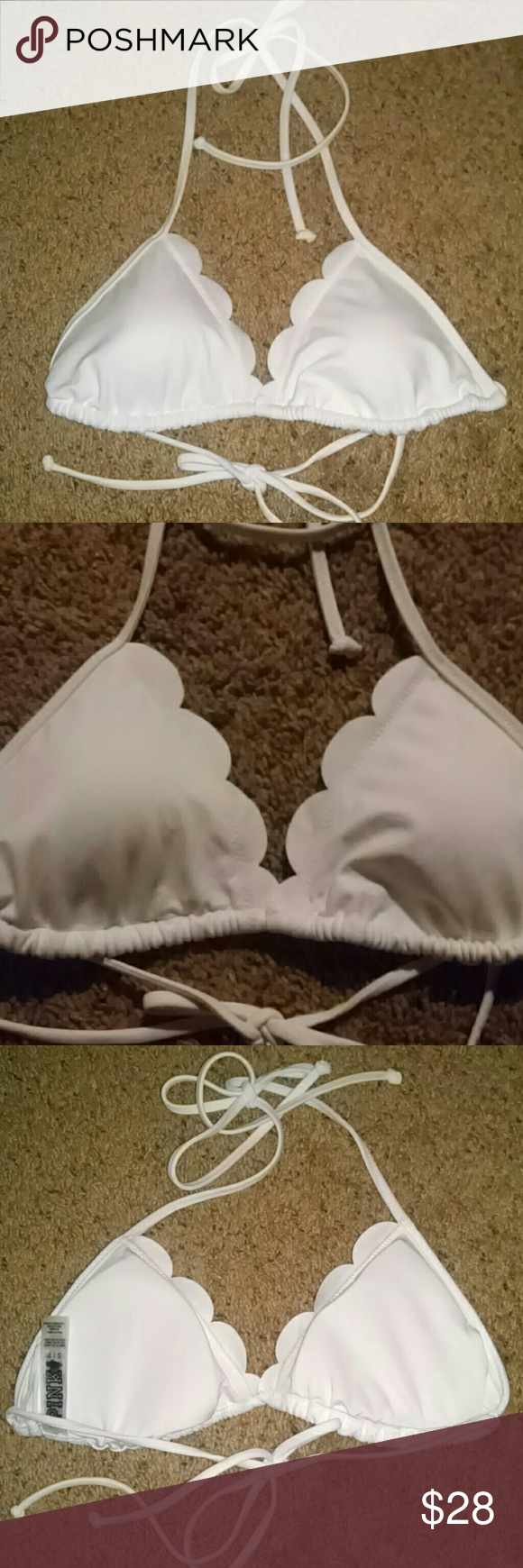Victoria's Secret Pink Bikini Top White Small Victoria's Secret Bikini Top White Ties At Neck & Back Lightly padded removable cups Size Small  Fabric Nylon/Elastane  NEW without tags VS tags have been cut out or marked through to prevent store returns Care tag intact Victoria's Secret Discontinued their swimsuit line. Sale item PINK Victoria's Secret Swim Bikinis
