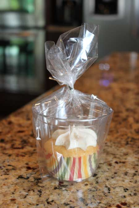Use clear plastic cups for packaging individual cupcakes (perfect for a bake sale, table favor, or gift.)