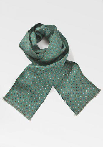 Ein elegantes Blumenmotiv in beige, orange und navyblau ziert den glänzenden Untergrund dieses hochwertigen Krawattenschals in gesättigtem flaschengrün. Der hippe Tuchschal begeistert den lebensfrohen Bonvivant ebenso wie den seriösen Geschäftsmann. Immer eine gute Idee nicht nur zu Haute Couture, sondern auch am Wochenende. Der Krawattenschal besteht aus feinster Seide. Abmessungen: 160 x 15 Centimeter. Artikel-Nr.: KB7314X