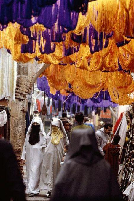 Marrakesh, Morocco. 1971. Women passing through a wool market. by Burt Glinn