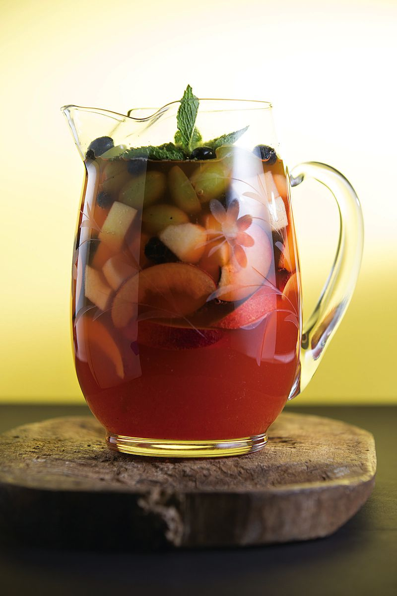 Stone Fruit Rosé Sangria-- This version of a Spanish sangria is ripe with summer fruit; its light, crisp flavors complement seafood and poultry.