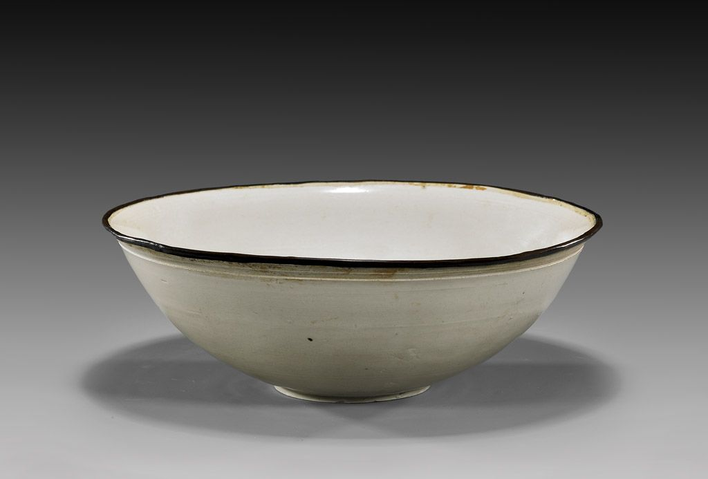 """Fine Chinese Song Dynasty, Dingyao glazed bowl; of unusually large size and of very fine, even color, mounted with copper rim; D: 9 1/2"""""""