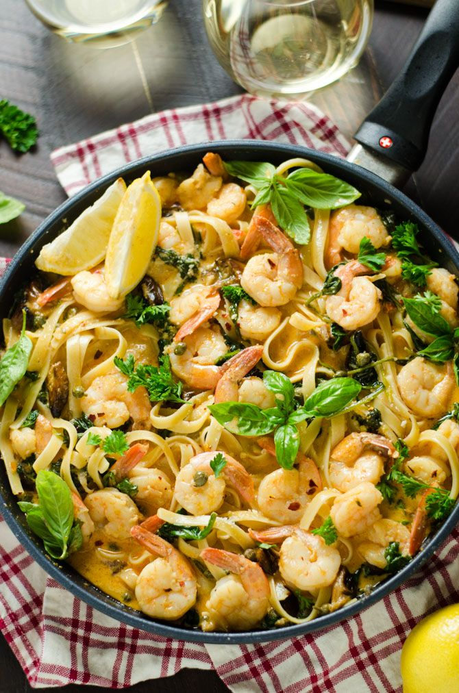 Creamy Lemon Butter Shrimp Pasta With Spinach And Caramelized Garlic Host The Toast Recipe Lemon Butter Shrimp Seafood Recipes Cheap Seafood Recipes