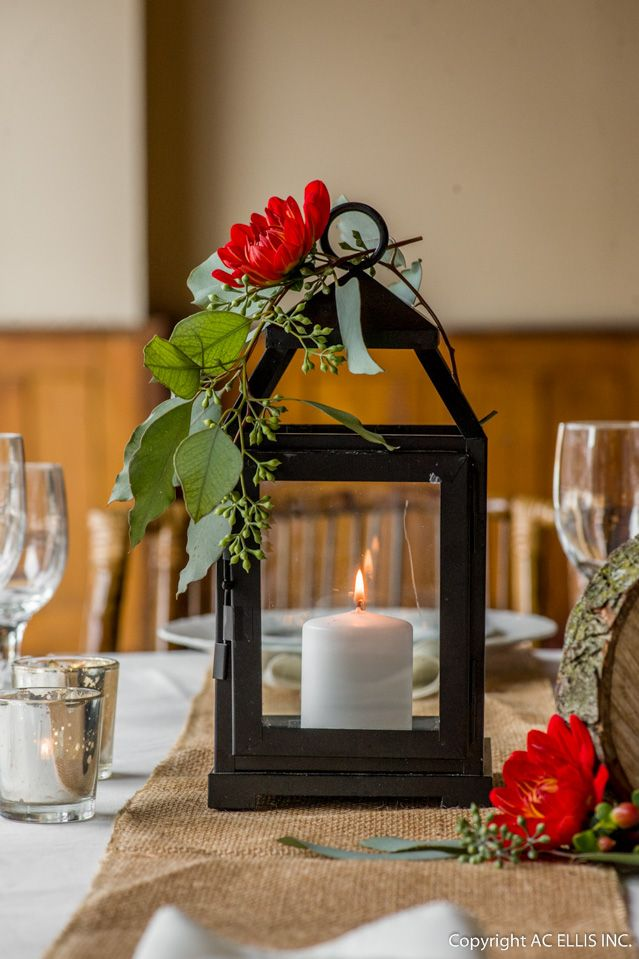 Black lantern centerpiece with floral accents bella rosa