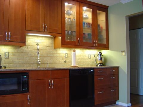 Ikea medium brown adel kitchen cabinets like the glass for Adel kitchen cabinets
