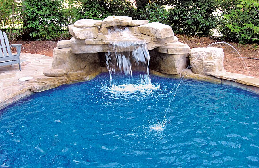 swimming pool with rock waterfall grotto and laminar jets