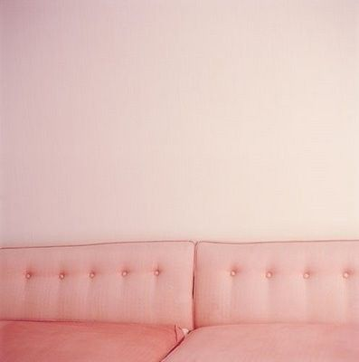 Pink couch and walls
