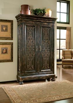 Ordinaire Scrolling Gate Armoire Is A Combination Of Form And Function It Features A  Distressed Dark Finish And Its Panels Feature Decorative Scrollwork Its  Spacious ...