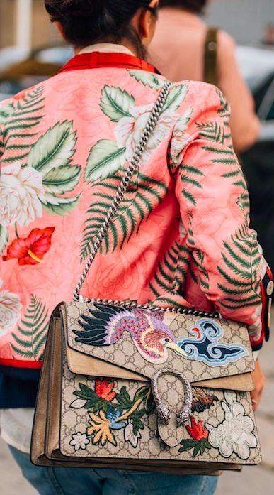 Prints are so on trend for Spring. Fashion-forward iterations like off-the-shoulder tops, ruffled hems and sleek accessories that can be worn anywhere, whether you're headed to the office or away on vacation. We love this printed palm bomber and embossed gucci bag