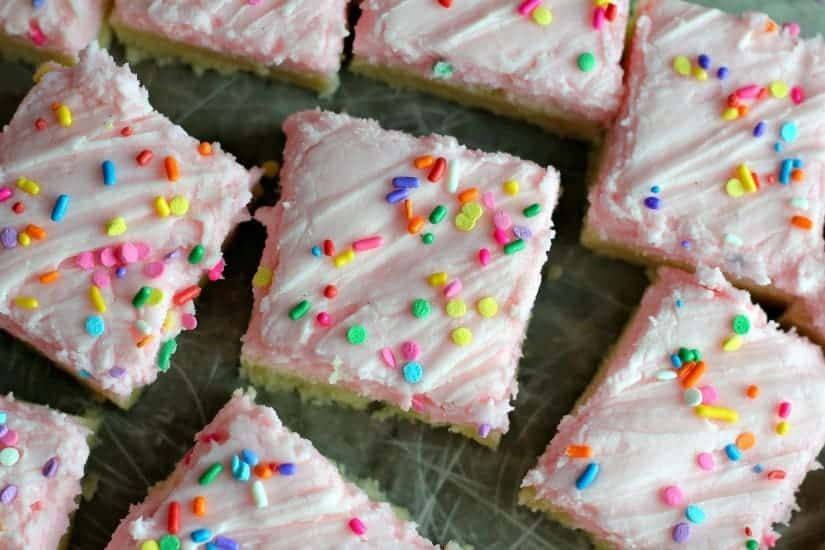 Frosted Soft Sugar Cookie Bars  Perfectly simple delicious traditional sugar cookies transformed into soft thick sugar cookie bars frosted with a cherry buttercream frost...
