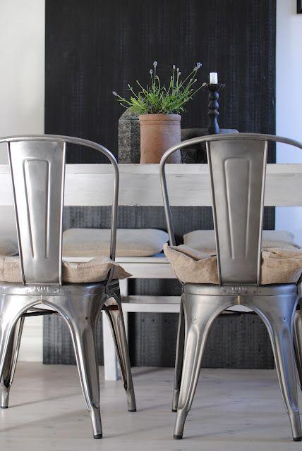 Tolix Chairs with a Black Door from Biskop's Garden