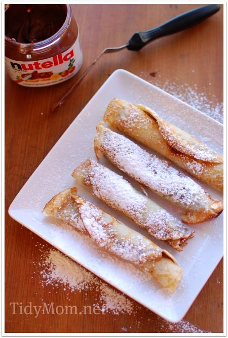 Nutella Crepes, just spread nutella on crepes, roll and dust with powdered sugar...I am so making my husband do this for breakfast this weekend!