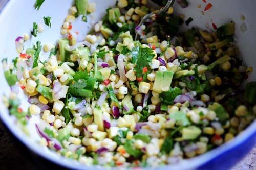 Fresh corn and avocado salsa...my absolute FAVORITE summer appetizer!  (I add fresh pineapple to mine too)