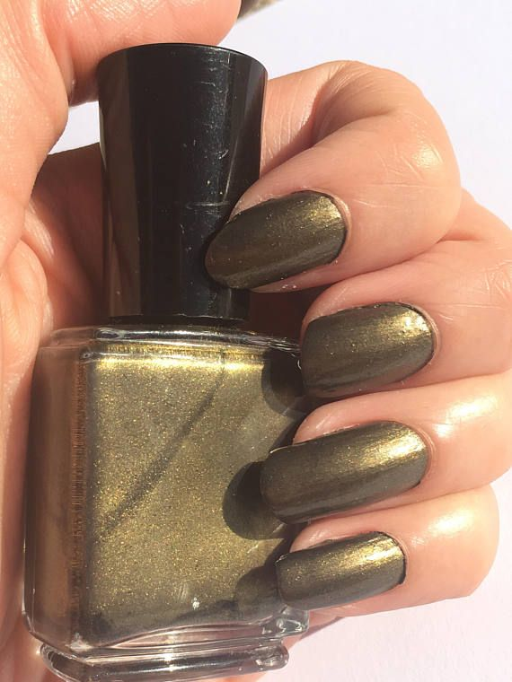 Black Gold is a black and gold colored nail polish. It shows black ...