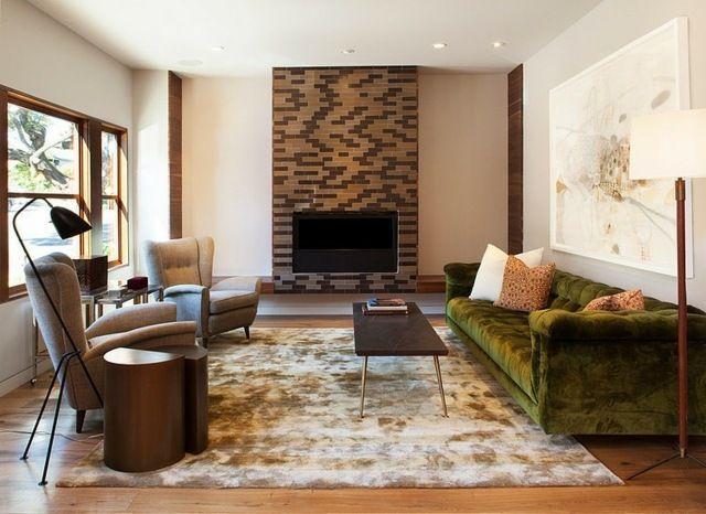 Wohnzimmer-neutrale Farben gestalten grünes Sofa Kamin зали