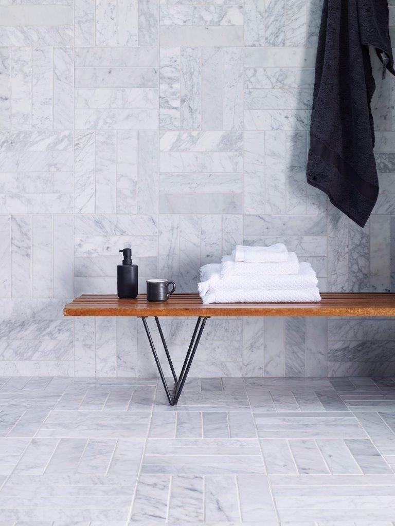 Carrara Honed Marble  strip  tiles laid in a cool grid herringbone format. Carrara Honed Marble  strip  tiles laid in a cool grid herringbone
