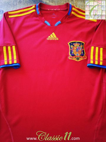 f938b80b940 Relive Spain's 2010/2011 international season with this vintage Adidas home  football shirt.