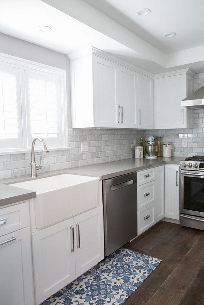 Beautiful Dark Gray Countertop Paired With White Cabinetry