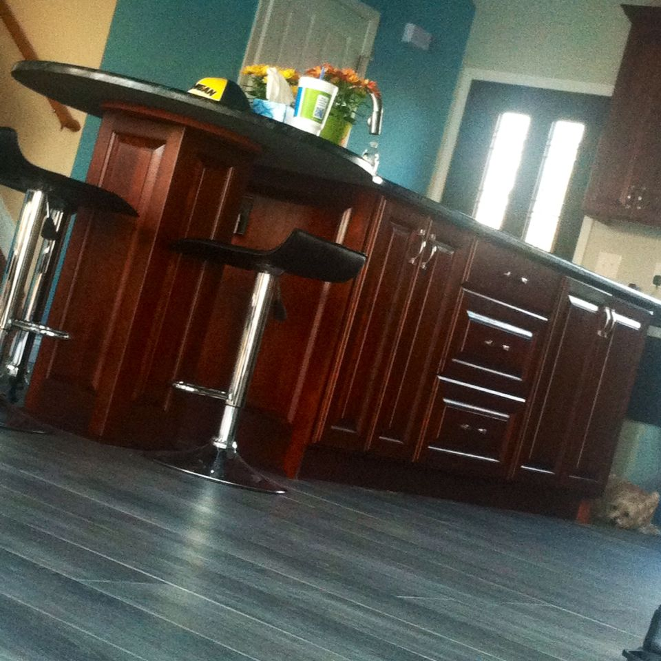 Our modern look kitchen. Black swivel chairs, grey wood like tile ...