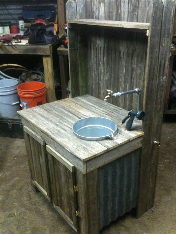 outdoor potting bench/cabinet, hooks up to a water hose ...