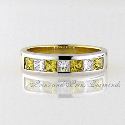 There are 3 = 0.445ct FG/VVS – VS princess cut diamonds and 4 = 0.71ct princess cut yellow sapphires channel set in 18k yellow and white gold two-tone half eternity