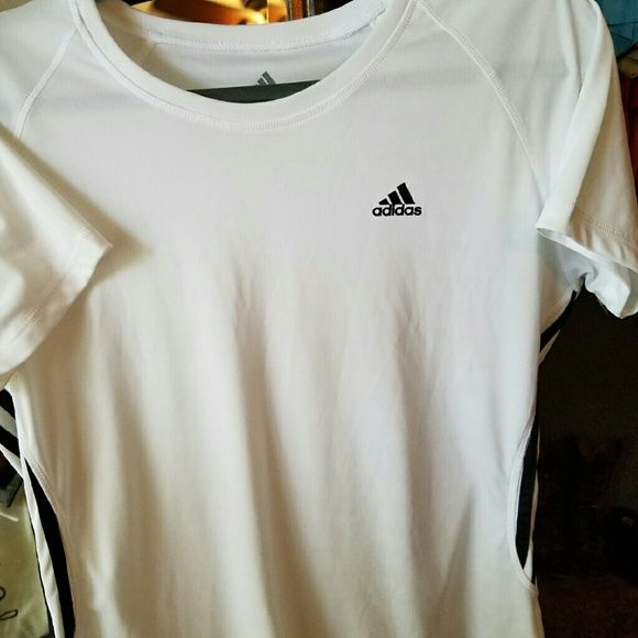 Ladies Adidas workout top sz large Ladies sz large Adidas workout top in excellent condition, Has black pinstripe sides and Adidas logo on front. Tops Tees - Short Sleeve