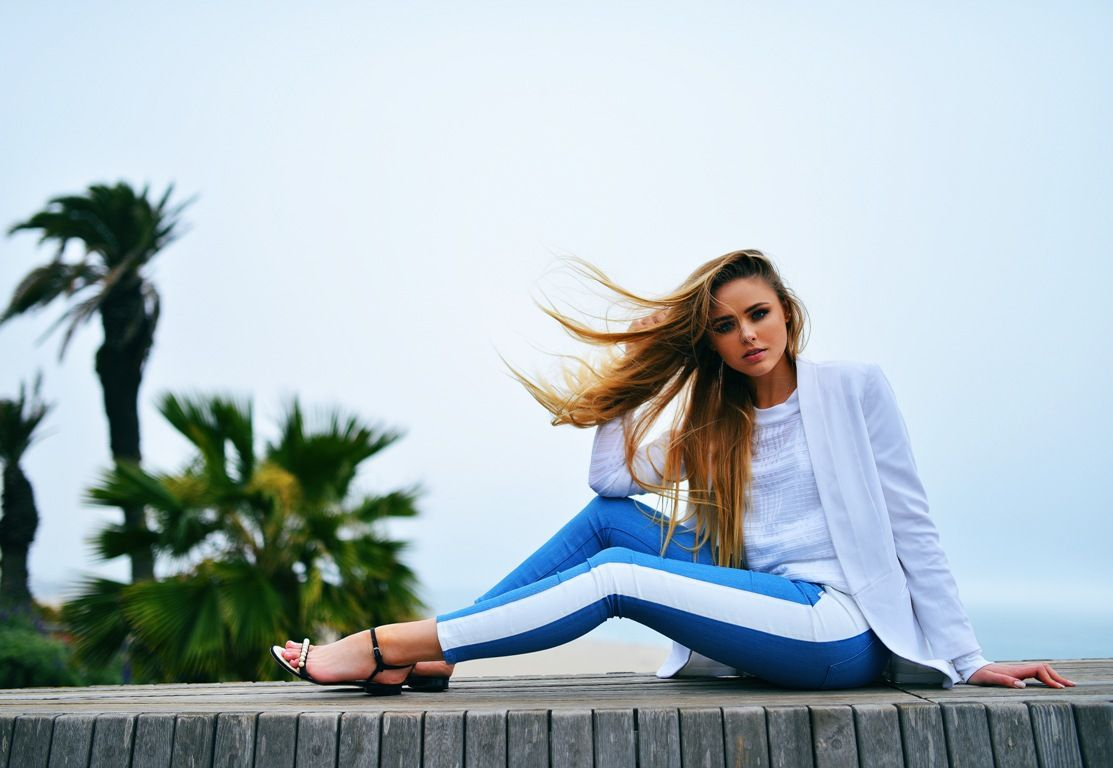 white blazer and top with striped pants