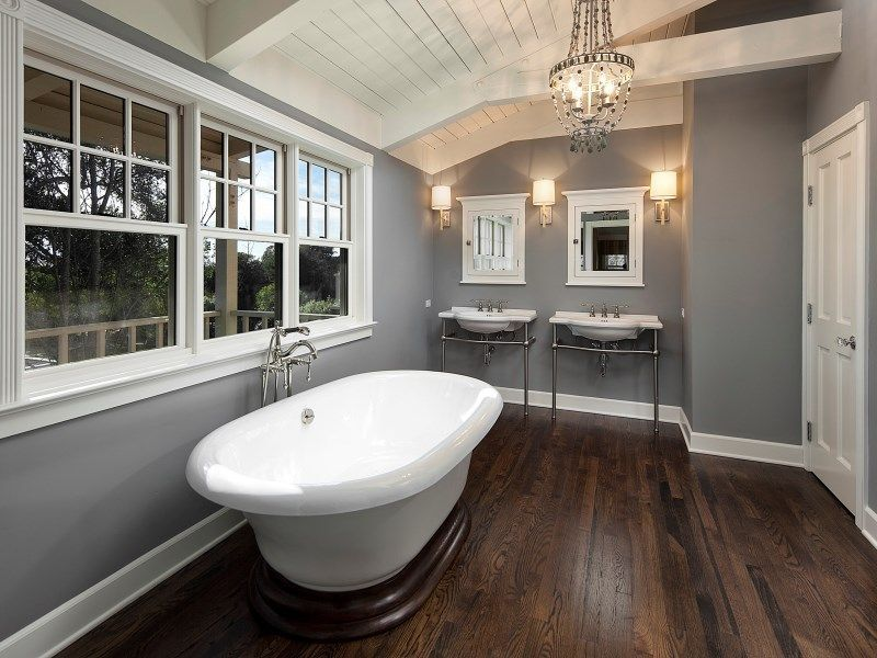 Grey and white shiplap luxury bath with wood floors ...