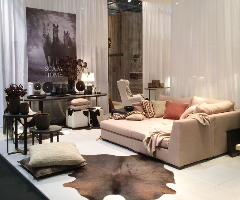 Scapa Home, Modular Sofa, Cow Skin Rug, Dining Table, Candles.