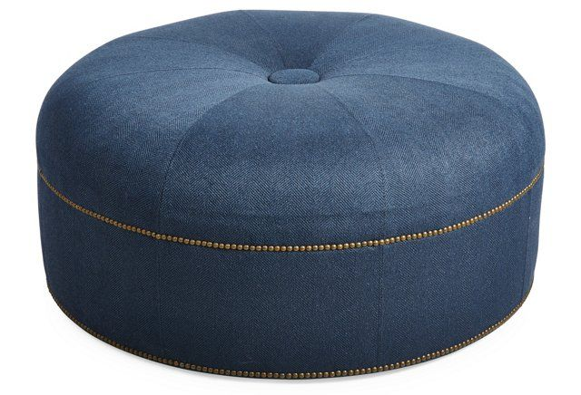 Love the nailhead detailing on this sleek cocktail ottoman.