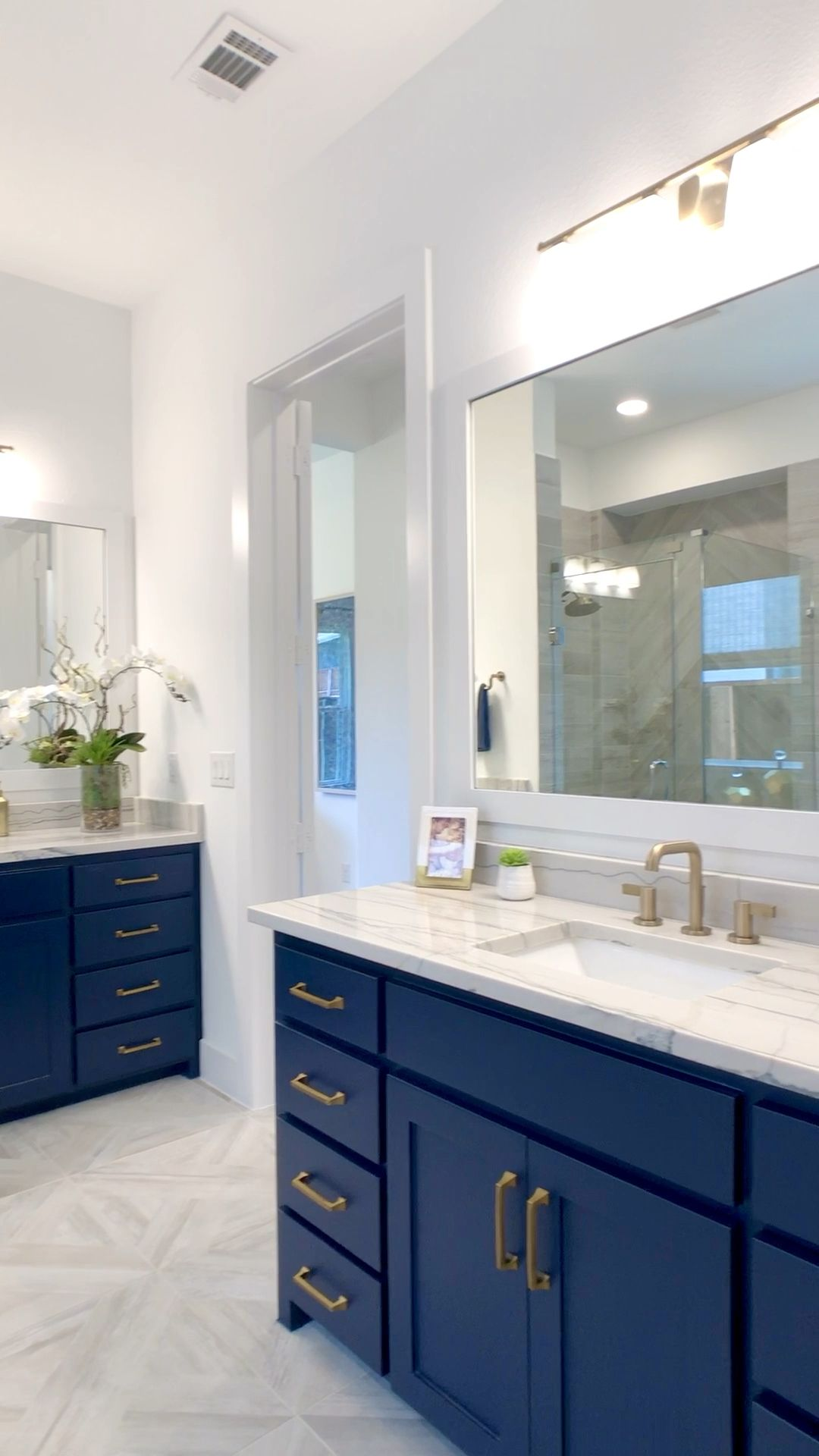 Photo of Navy Blue Bathroom cabinets with Gold Hardware