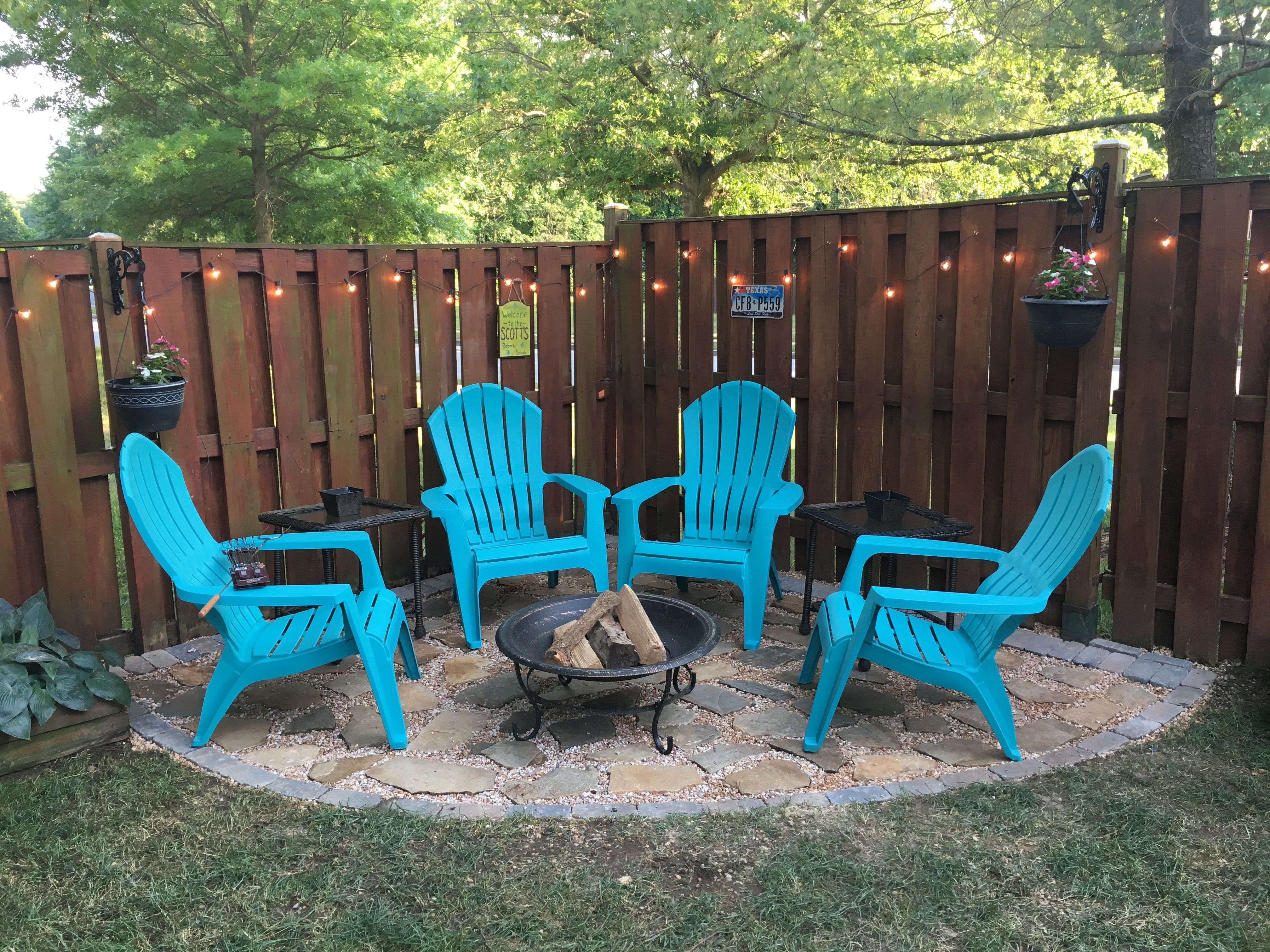 Diy flagstone patio complete with a fire pit cafe lights