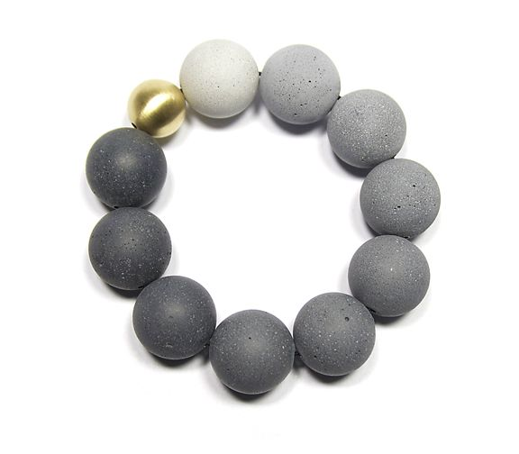 KONZUK, The new Orbis 18k gold and tinted concrete bracelet, coming soon.