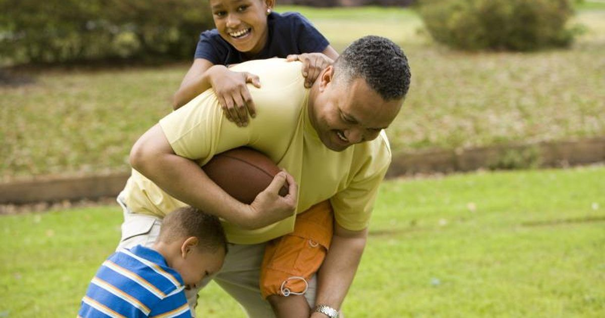 Keep your kids entertained as well as improve their throwing and catching skills with some outdoor football games. While a basic game of football can be played by kids of all ages, a variety of different types of football games help to break the game down depending on age and competition level.