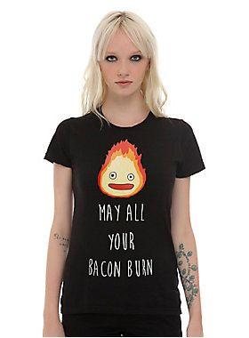 <p>After Sofi puts a pan on top of Calicifer her curses her bacon. Place the same curse on those who upset you by wearing this black tee with Calcifer on it.</p>  <ul> <li>100% cotton</li> <li>Wash cold; dry low</li> <li>Imported</li> <li>Listed in junior sizes</li> </ul>