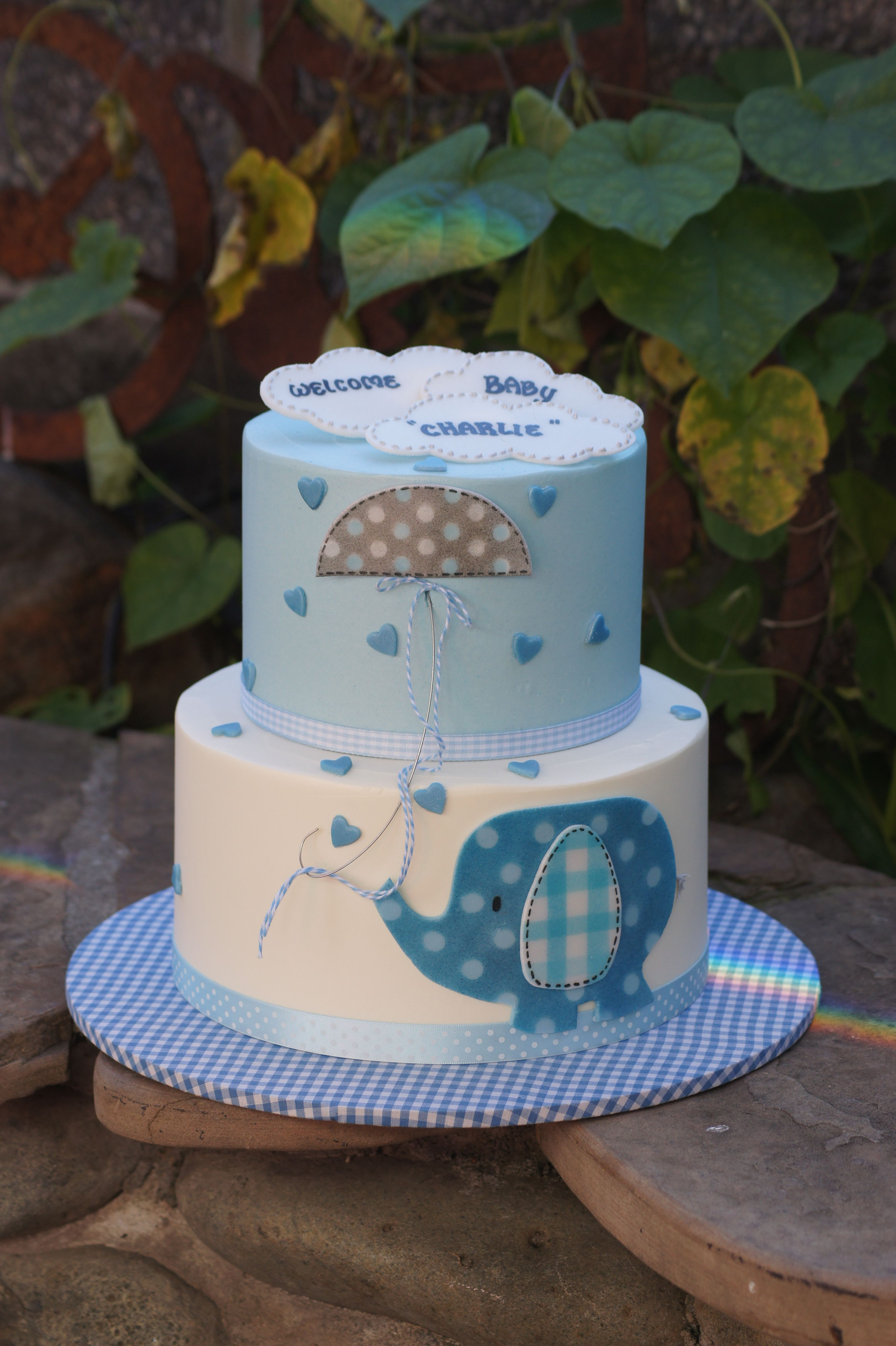 Blue and white elephant baby shower cake