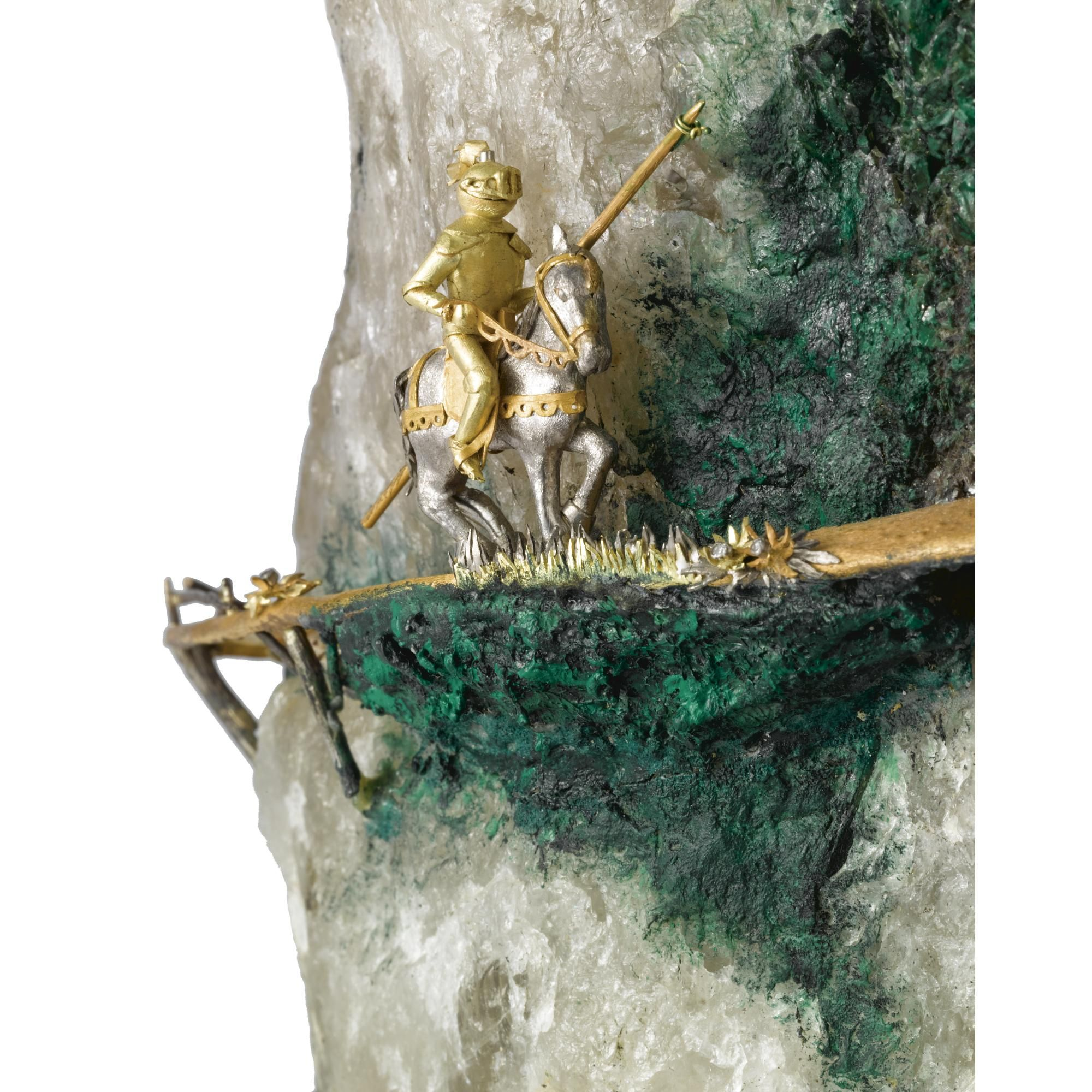 "AN ENGLISH GOLD, SILVER AND MINERAL SPECIMAN ""FAIRY TALE"" CASTLE, WILLIAM TOLLIDAY, LONDON, CIRCA 1980 mounted on a rocky mountain of rock crystal with pyrite inclusion, all on a faux malachite base, the many turreted castle of gold with oxidized silver roofs, complete with draw bridge, a knight in armor approaching on a serpentine gold path, strewn with diamond-set flowers, at the base a fisherman in a boat, floating on a striated agate pond with willow tree at one side"