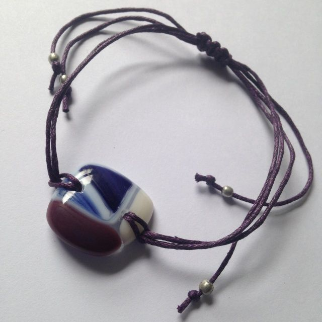 This bracelet is hand crafted by myself, using fusing glass which has been hand cut and kiln fired. Drilled and finished with Hemp cord and recycled metal beads, with a sliding braid so that is fully adjustable.I have spent time with thispiece infusing it with the Usui Reiki symbols and vibration.This is a unique piece, as is the nature of glass fusing.The glass element measures approximately 23mm square.This bracelet comes packaged in a jewellery gift box.If you have any questions or…