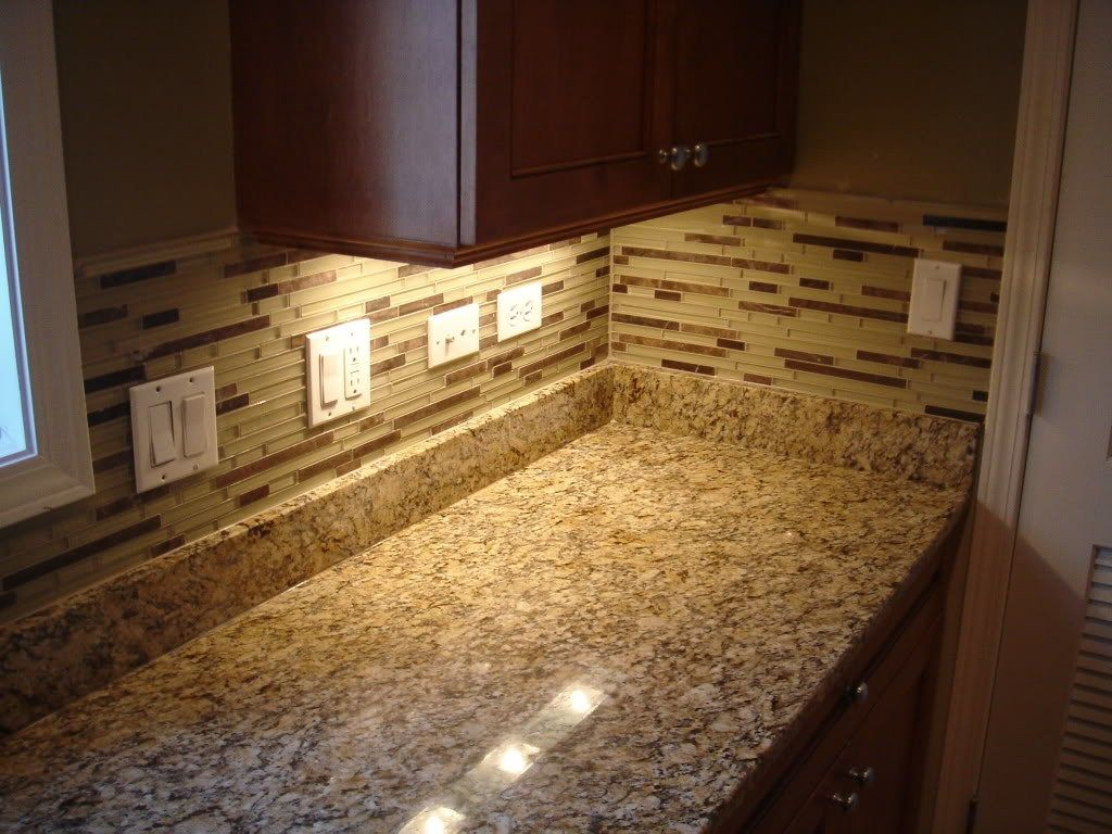 Cozy Countertop Design With Giallo Ornamental Granite Mosaic Tile Backsplash With Under Cabinet