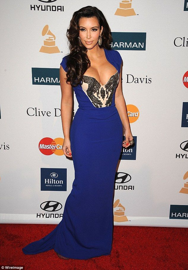 A babe in blue:For her trip to the music weekend of the year in 2012 she said: 'For Clive...