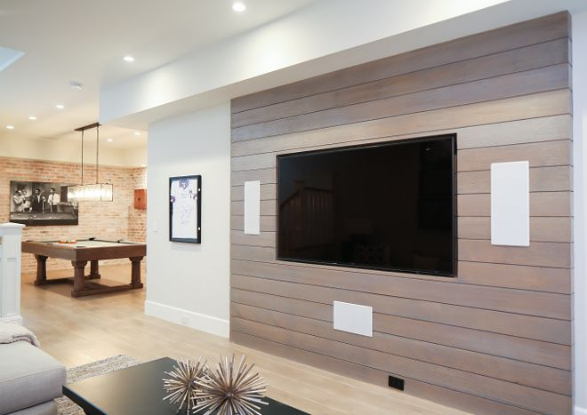 The Tv Room Features A Whitewashed Shiplap Accent Wall