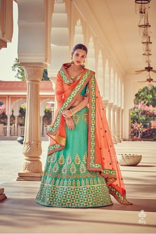 Price @11955.00 INR  Colour : Green & Orange  Top Material : Silk  Lehenga Material : Art Silk & Georgette  Dupatta Material : Net  Work : Heavy Embroidery With Hand Work