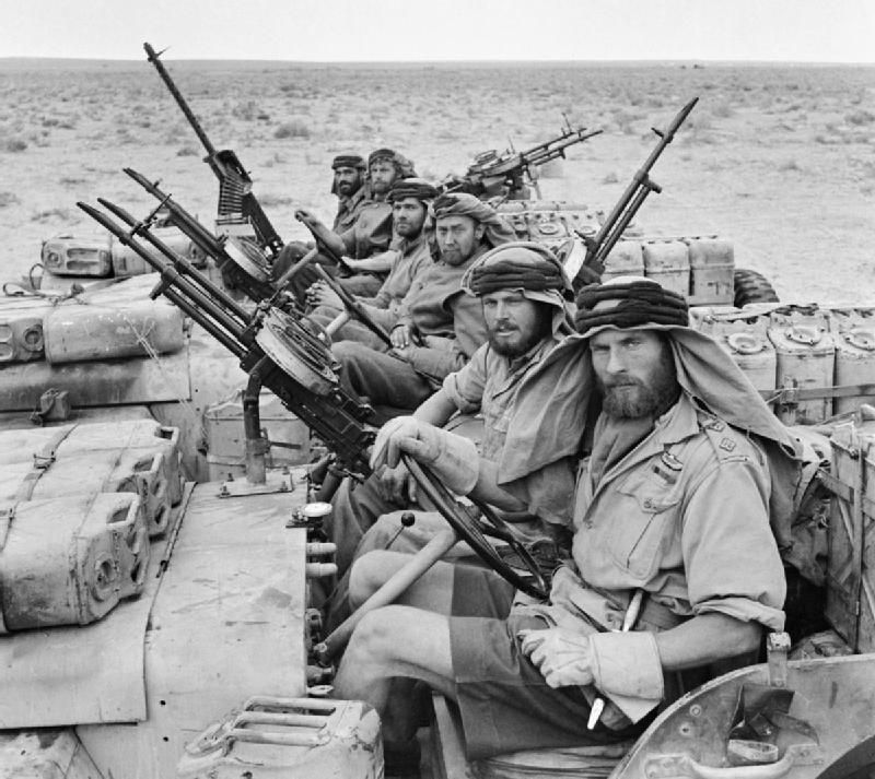 A British SAS team, returning from a three-month desert patrol during the North African campaign (January 18, 1943). The Jeeps were stripped of all unnecessary parts to save weight for fuel, provisions, and machine guns.