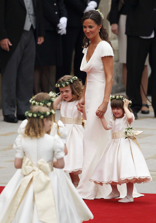 Pippa middleton wears ivory alexander mcqueen to the royal wedding pippa middleton wears ivory alexander mcqueen to the royal wedding ombrellifo Gallery