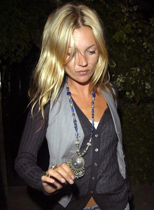 Kate. Vest over cardigan. Interesting combo.