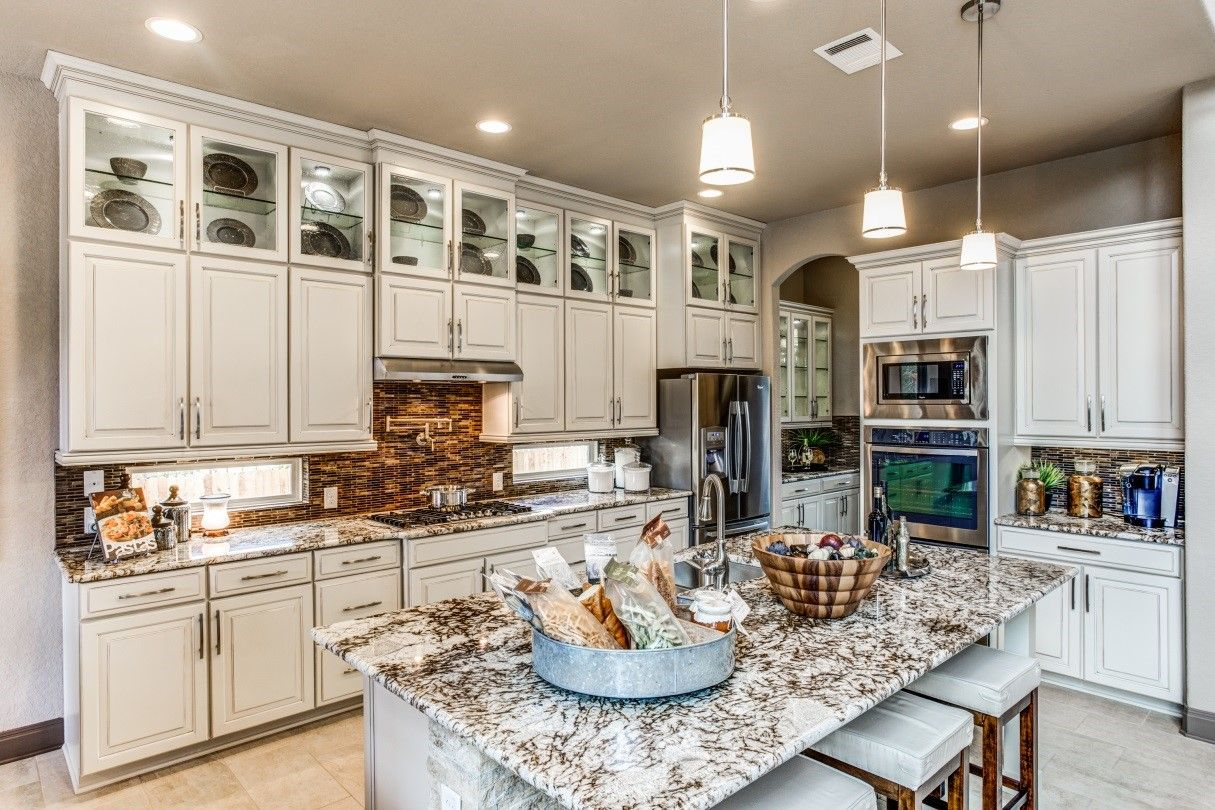 New Homes For Sale In San Antonio Tx By Ashton Woods Glass Kitchen Cabinets New Homes For Sale Glass Kitchen