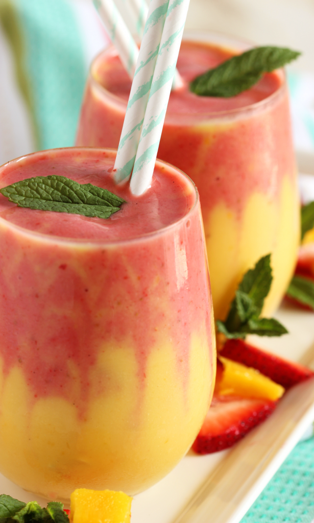 Looking for a refreshing breakfast? This mango strawberry smoothie recipe is really two smoothies, layered in a glass and garnished with fresh ginger.