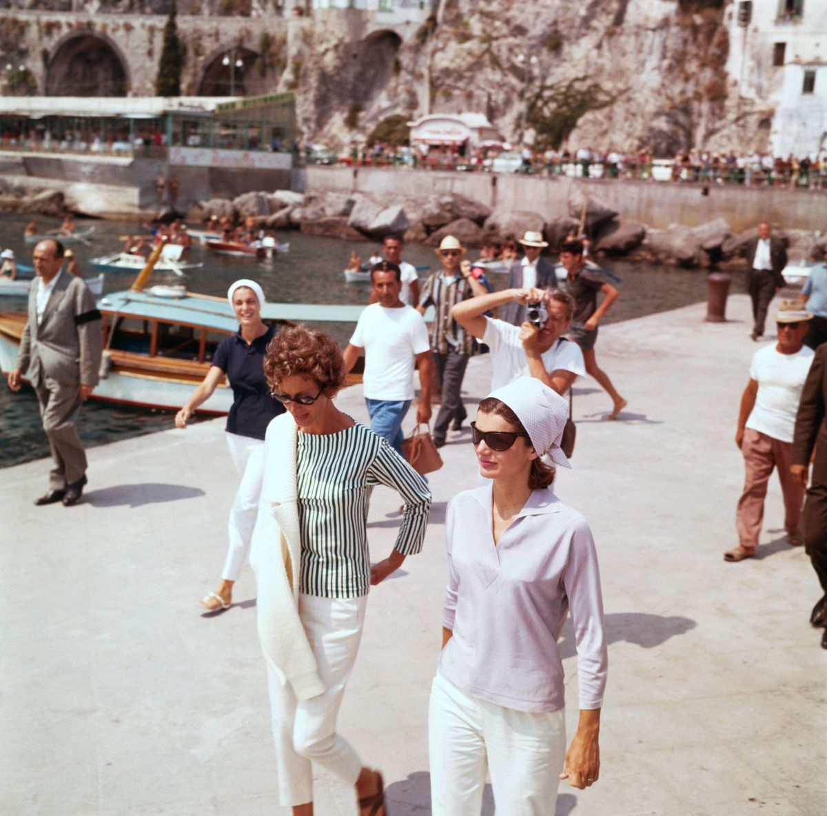 Jackie with Mrs Agnelli on a pier in Amalfi before embarking on the yacht  Agneta - August 1, 1962
